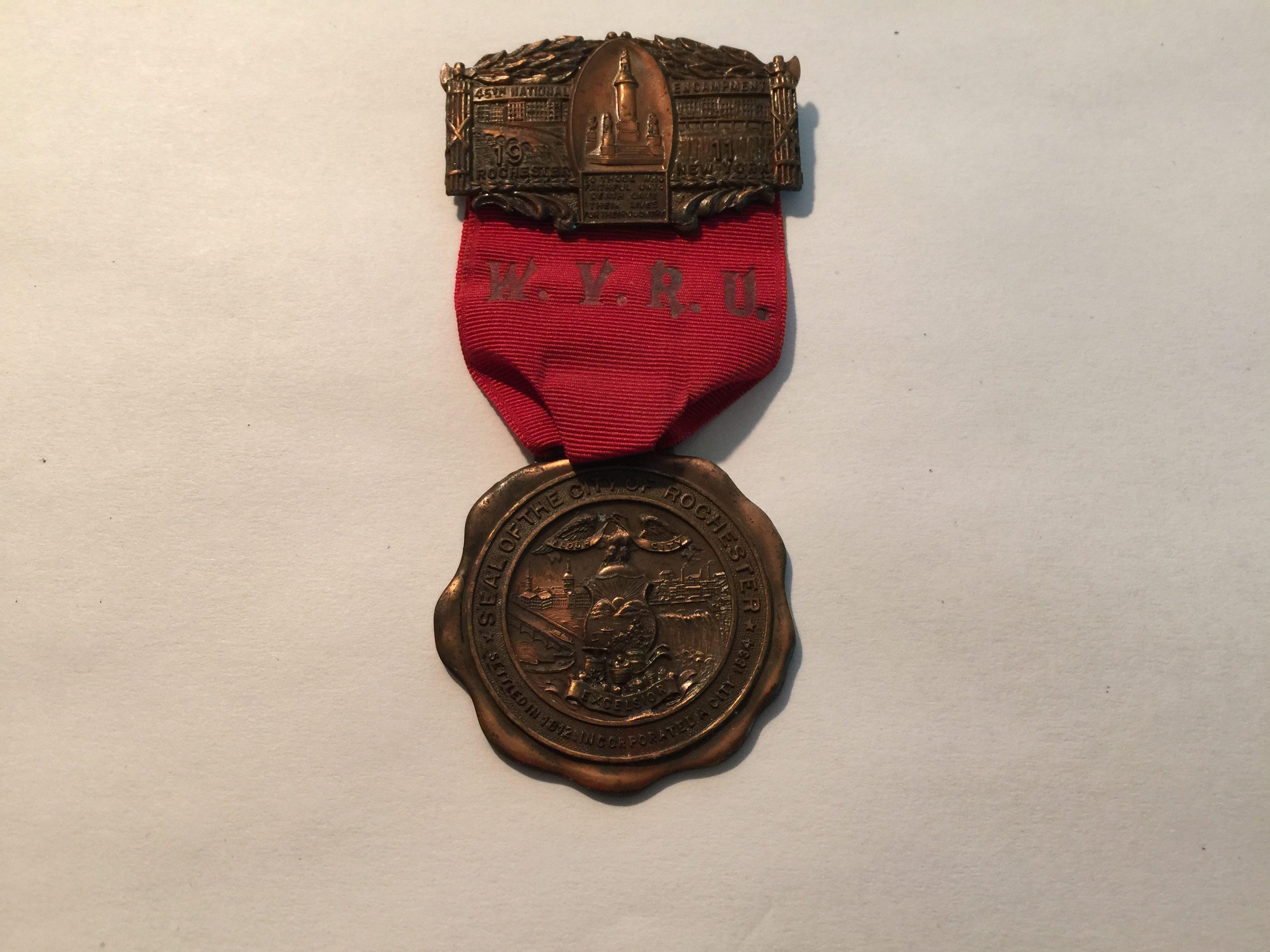 1911 GRAND ARMY REPUBLIC WOMENS VETERANS RELIEF UNION 45TH ENCAMPMENT MEDAL